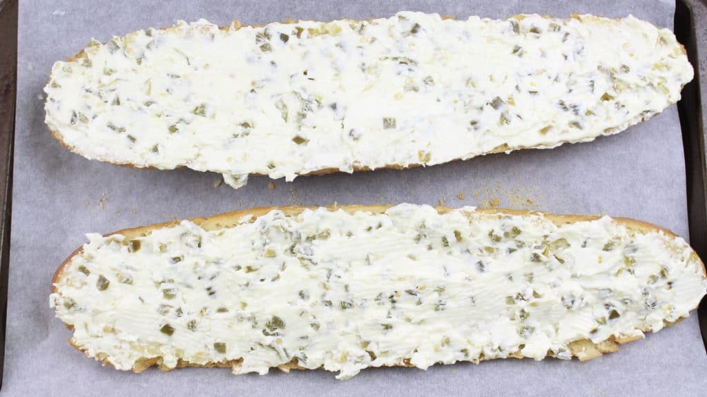 jalapeño cream cheese mixture spread on garlic buttered bread