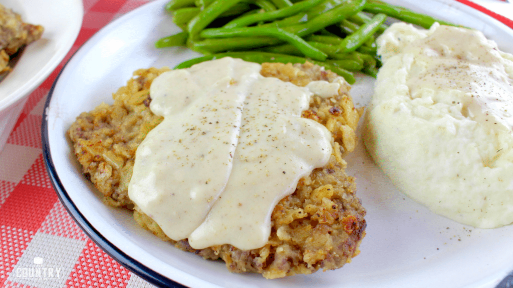 Chicken Fried Steak with Sawmill Gravy served on a plate