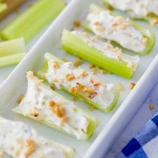 tray of celery stuffed with cream cheese, vegetable soup mix and topped with walnuts