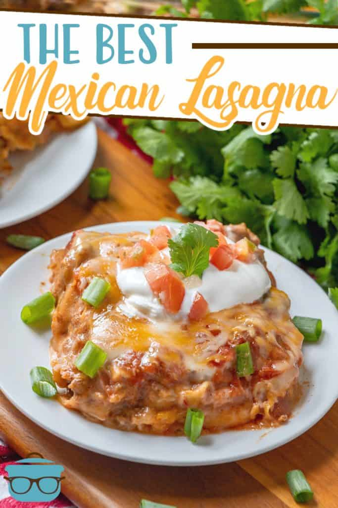 The Best Mexican Lasagna recipe from The Country Cook, slice shown on a white plate with parsley in the background