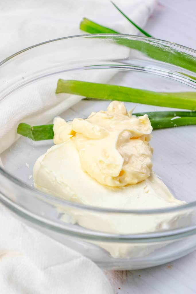 mayonnaise and softened cream cheese mixed together in a clear bowl
