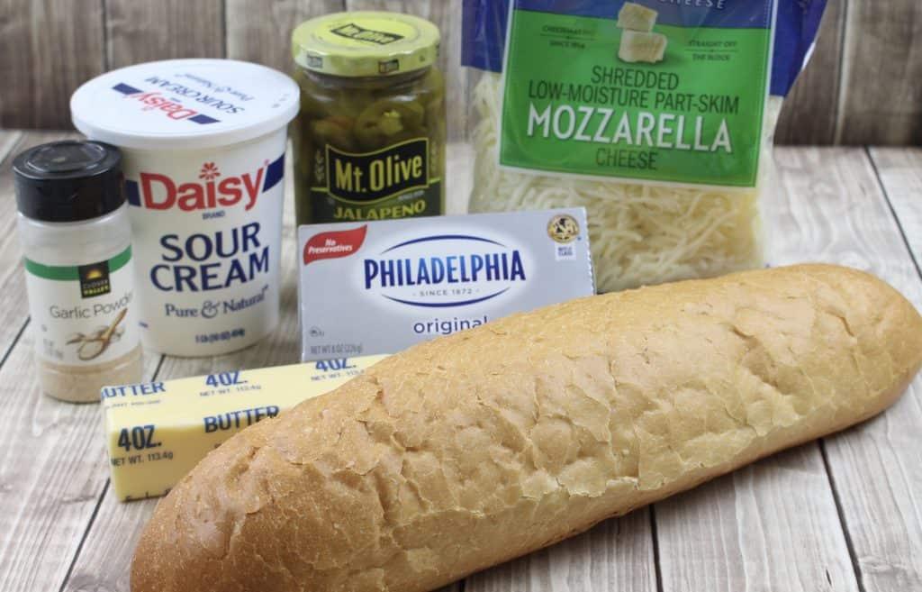 Italian bread, garlic powder, sour cream, cream cheese, jalapeño peppers, mozzarella cheese and butter