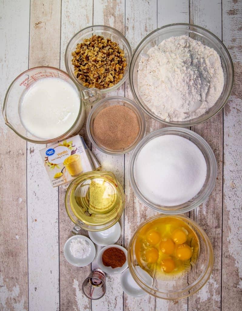 buttermilk, oil, large eggs, vanilla extract, sugar, ground cinnamon baking powder, baking soda, salt, all-purpose flour, instant vanilla pudding, chopped walnuts