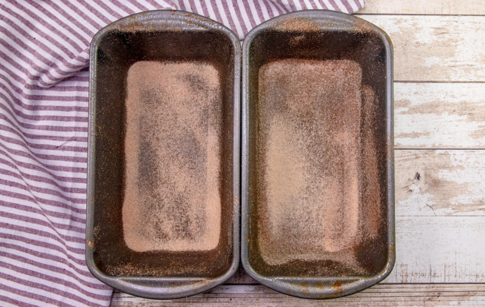 cinnamon sugar sprinkled into the bottom of two loaf pans