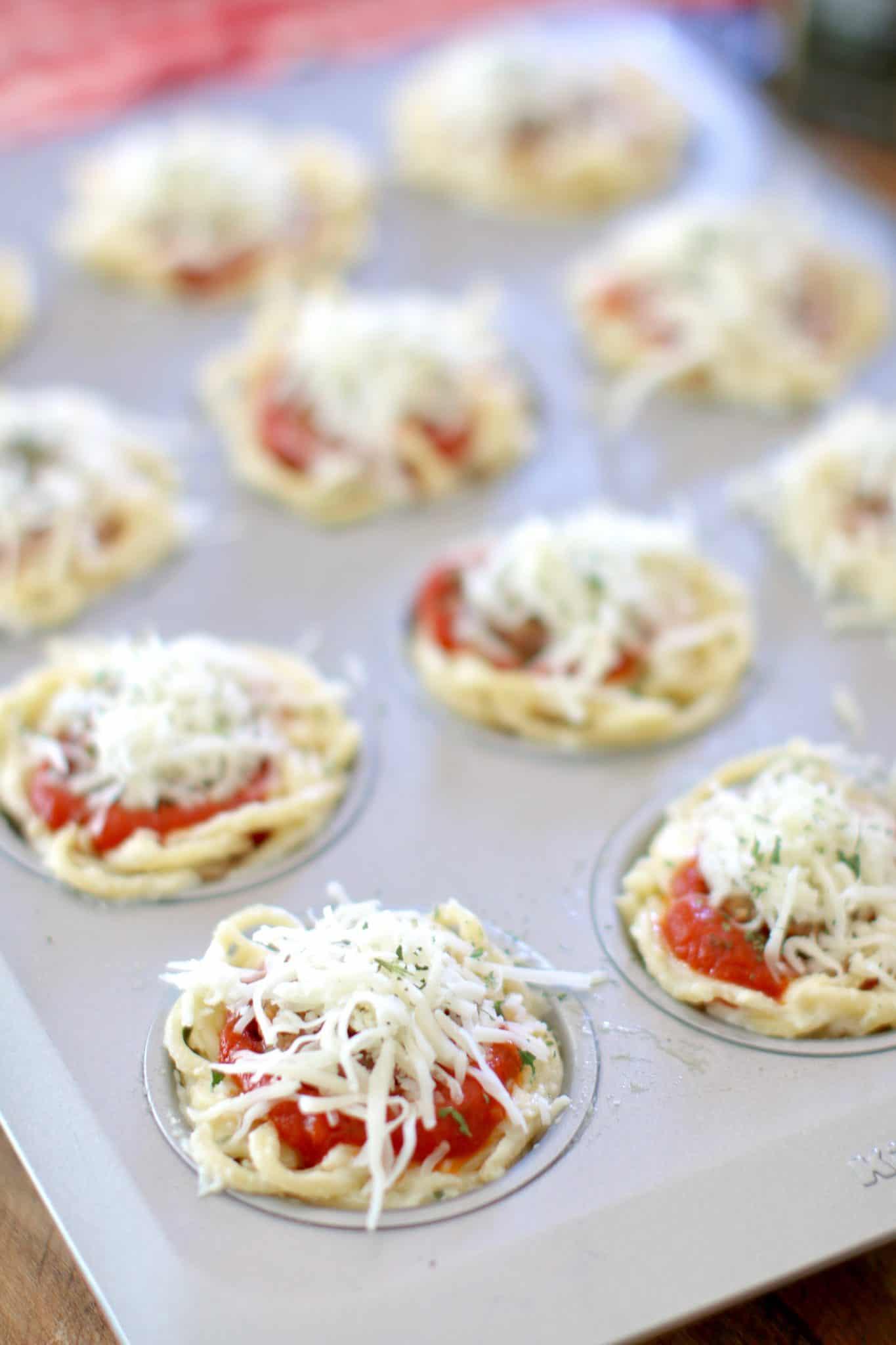 spaghetti cupcakes topped with mozzarella cheese