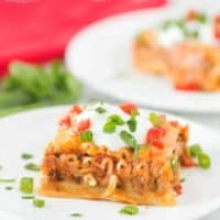 Mexican Lasagna with sour cream, tomatoes and green onion