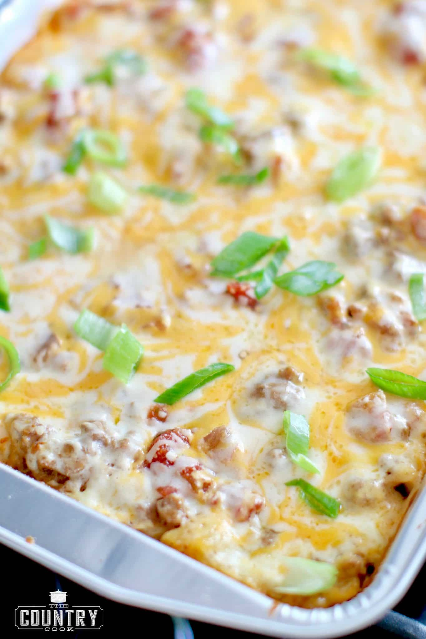 fulled baked Mexican lasagna with melted cheese and topped with sliced green onions