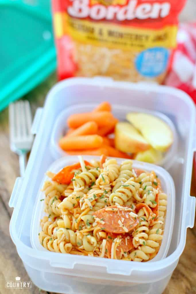 Packed kid's lunch, pasta salad, carrots and sliced apples, back-to-school