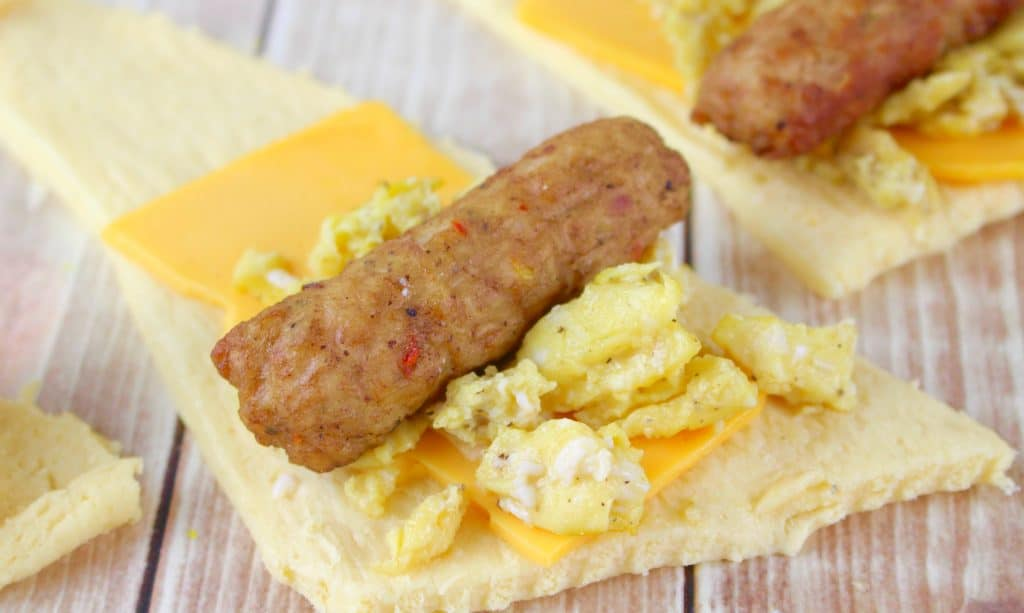 crescent roll, cheese, scrambled eggs and sausage link