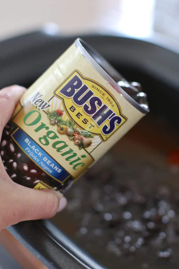 pouring BUSH'S Organic Black Beans