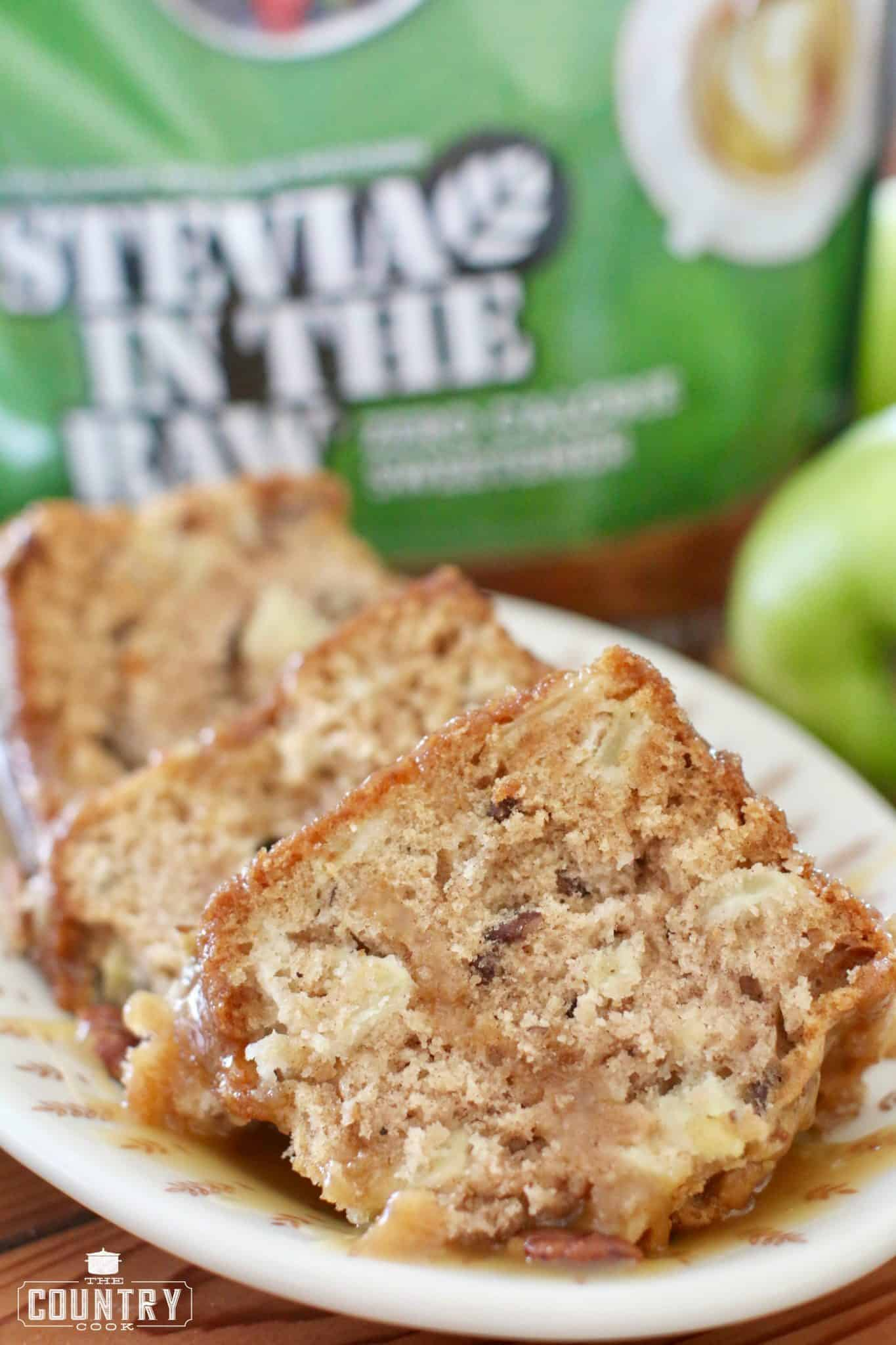 sliced fresh apple cake with stevia in the raw in the background.