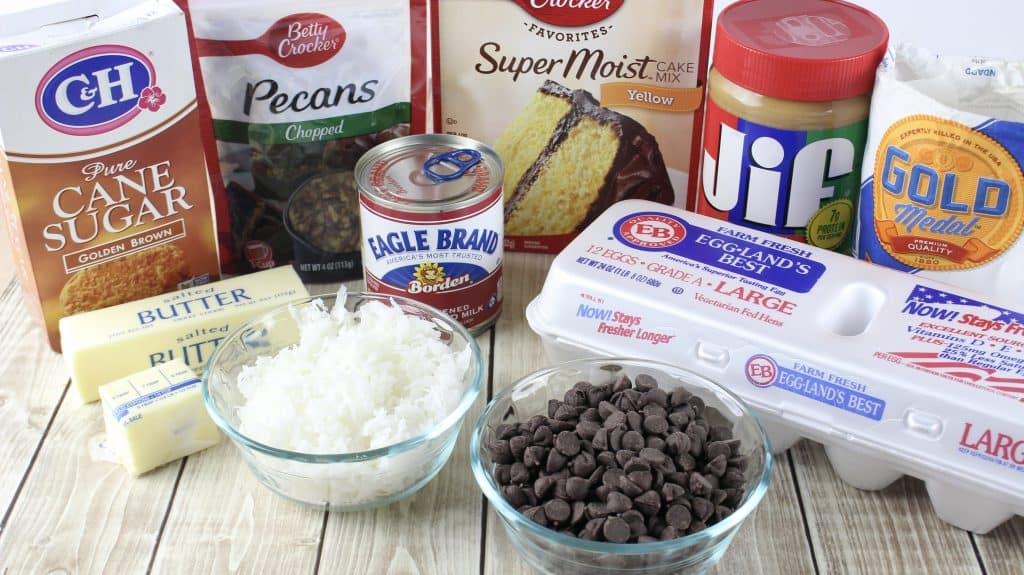cake mix, coconut, chocolate chips, peanut butter, sweetened condensed milk, butter