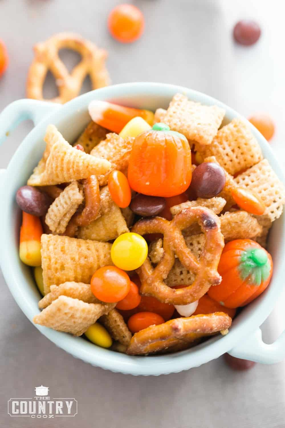 small white bowl filled with sweet chex mix.