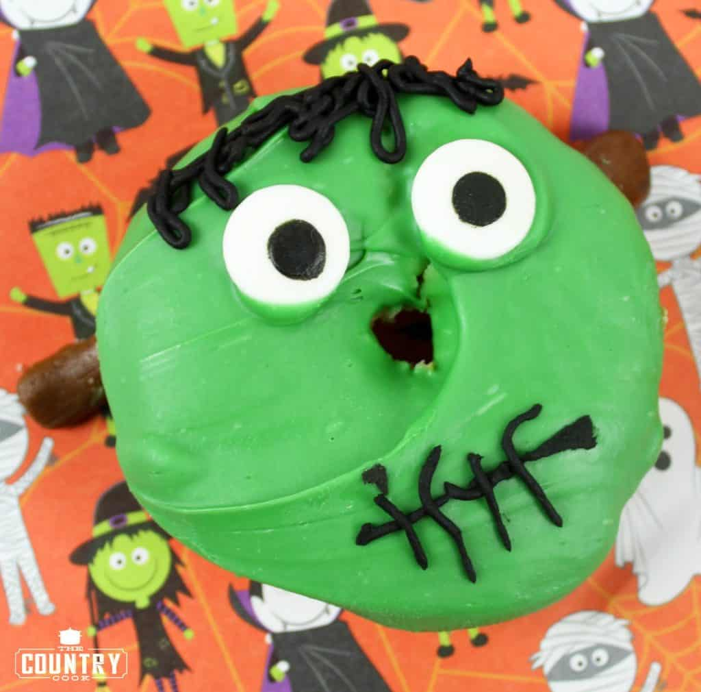cake mix donut with green icing and candy eyes