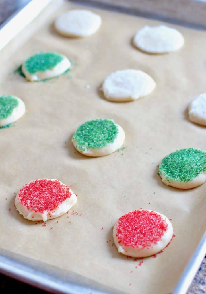 baking sheet with unbaked Christmas sugar cookies