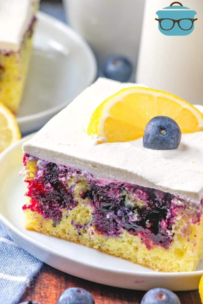 Lemon Blueberry Cake slice on a circle white plate
