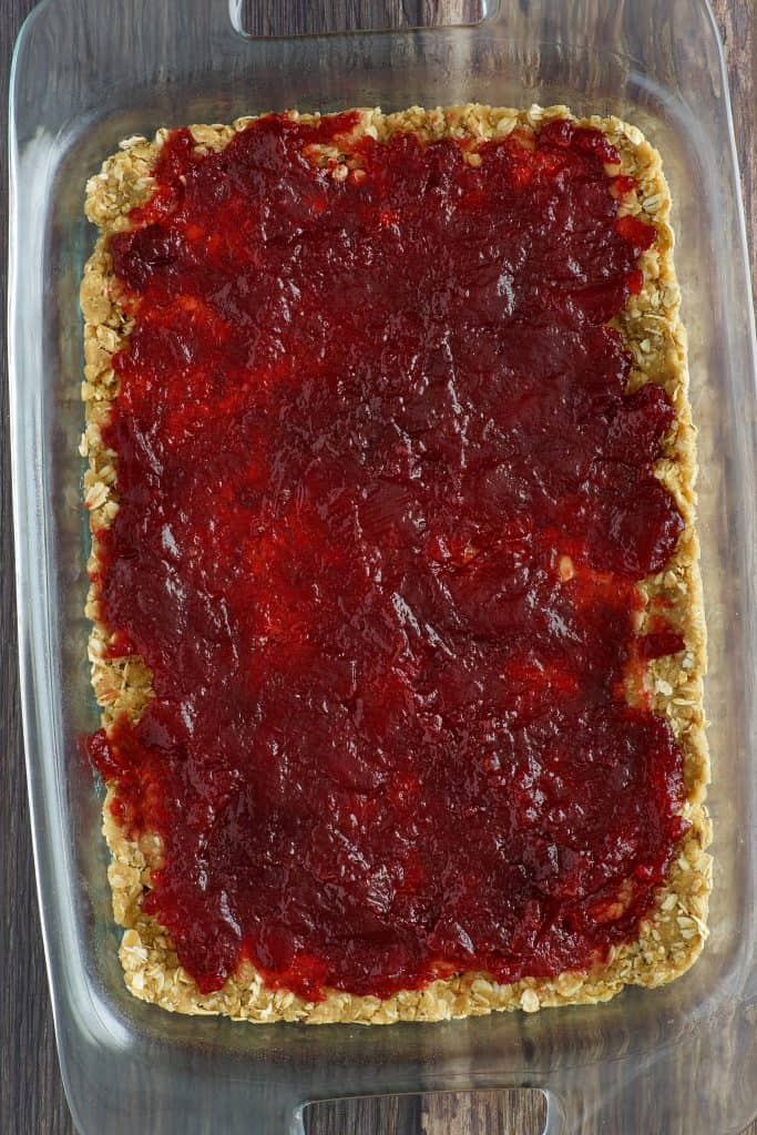 whole cranberry sauce spread over oatmeal mixture
