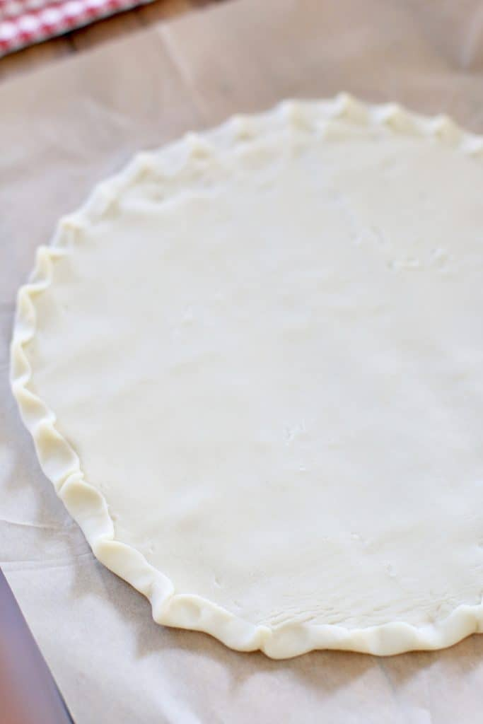 refrigerated pie crust placed on parchment