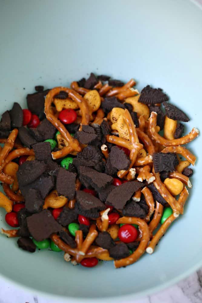 mint oreos, pretzels, goldfish, m&m's in a bowl