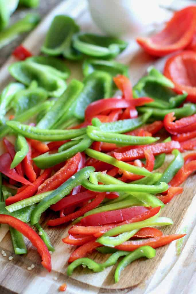 sliced green peppers, red peppers and onions