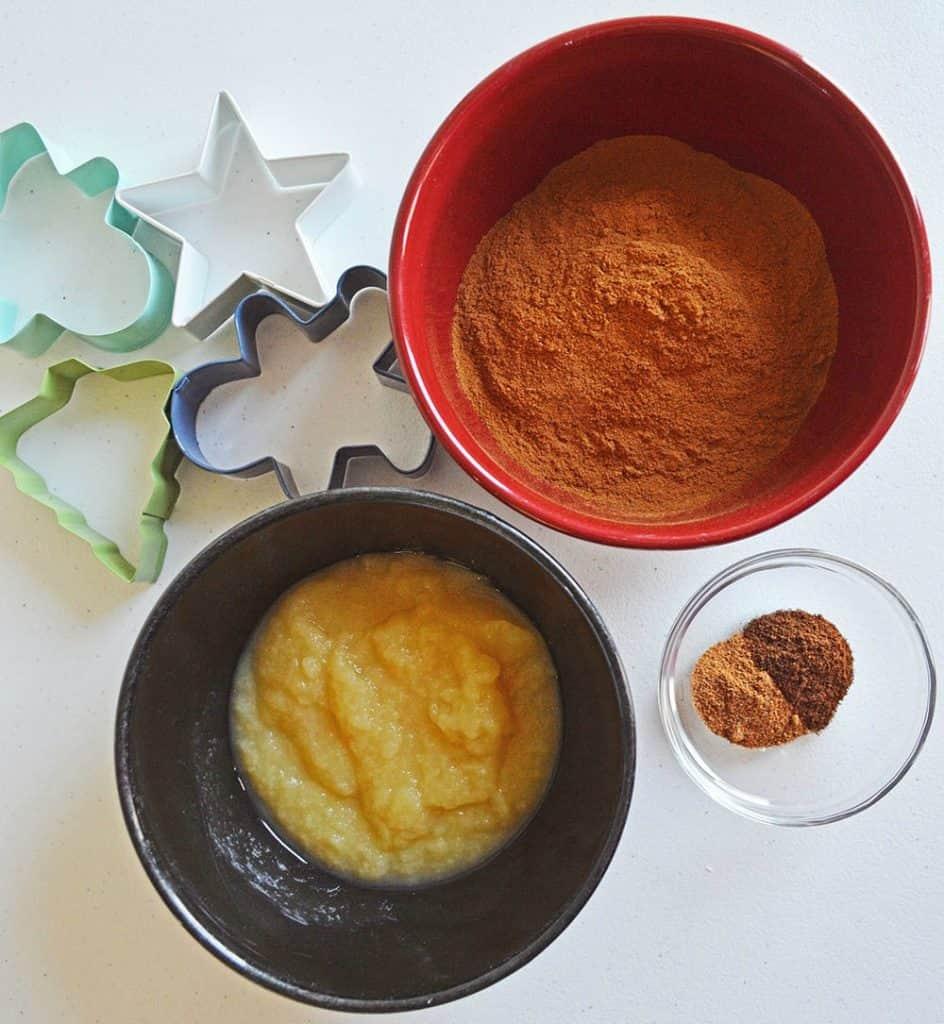 nutmeg, cloves, cinnamon, applesauce, cookie cutters