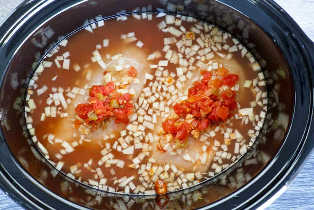 chicken broth, chicken breasts, rotten, taco seasoning in crock pot