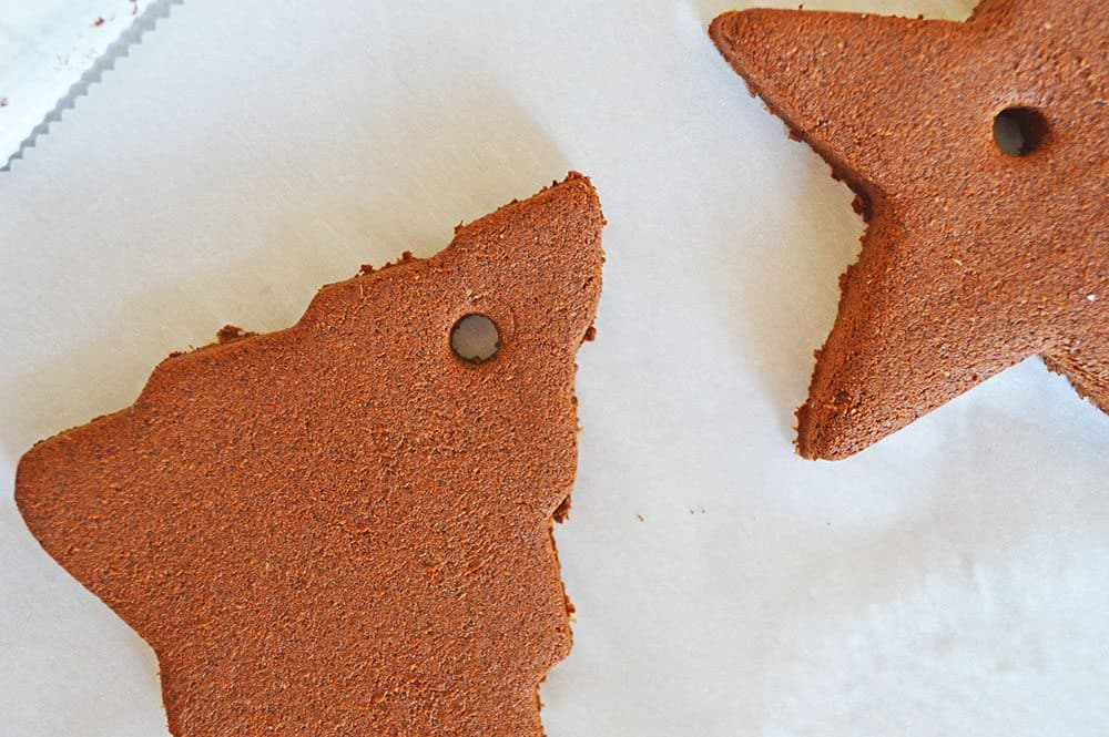 poked hole at top of cinnamon ornaments using a drinking straw