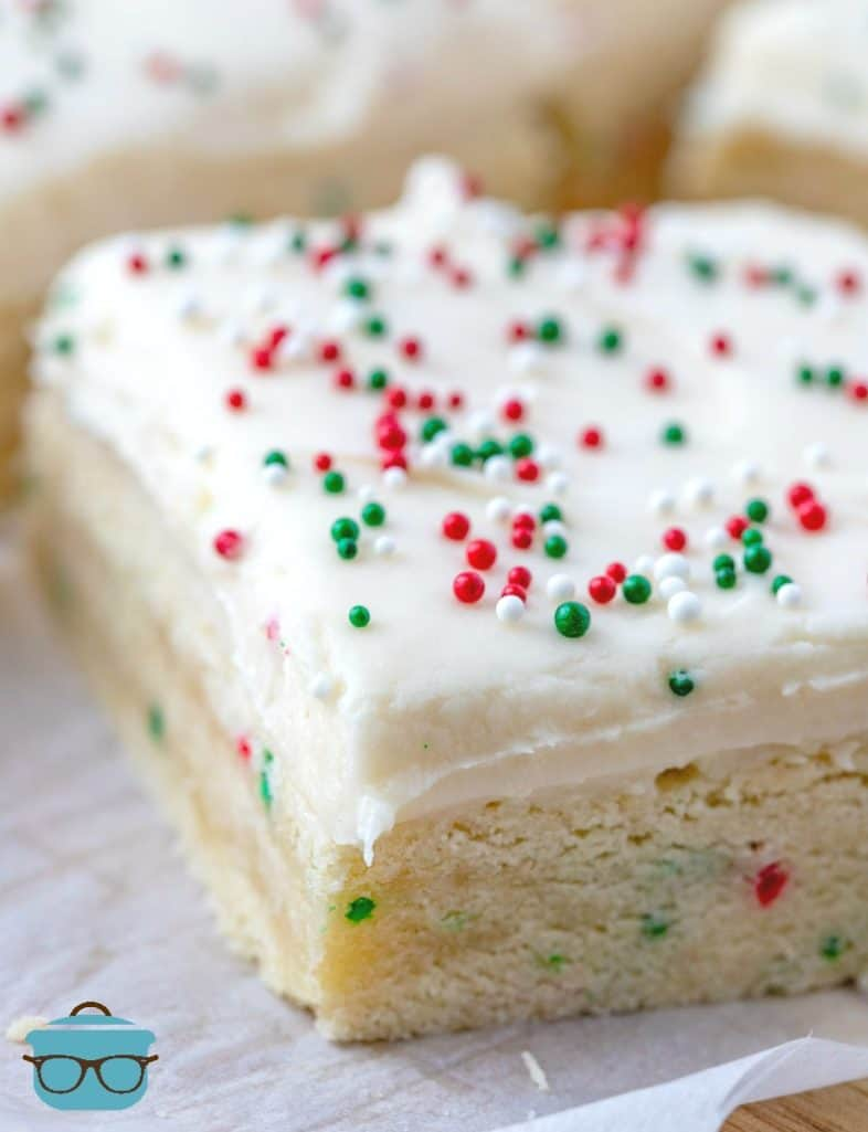 close up, homemade sugar cookie bars topped with cream cheese frosting