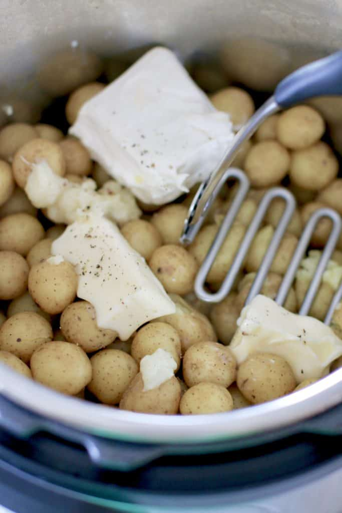 butter, cream cheese, garlic, salt and pepper added to steamed potatoes