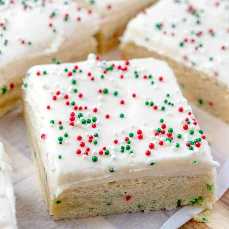 Holiday Sugar Cookie Bars topped with Cream Cheese Frosting