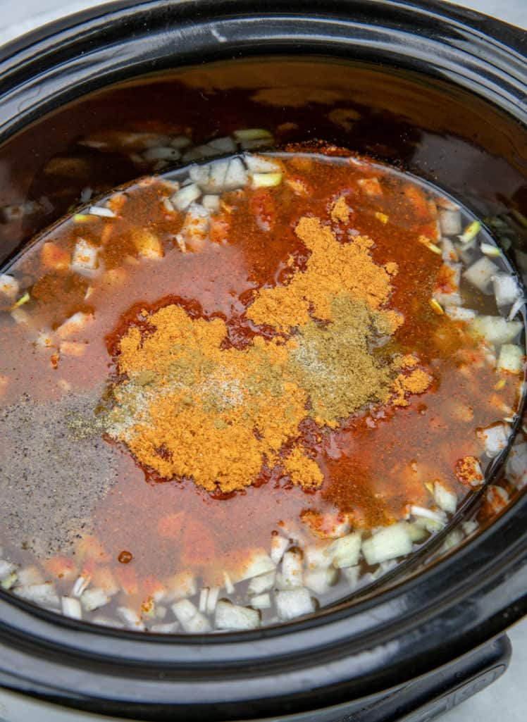 chicken breast, salsa, taco seasoning, diced onion in a 6-quart slow cooker