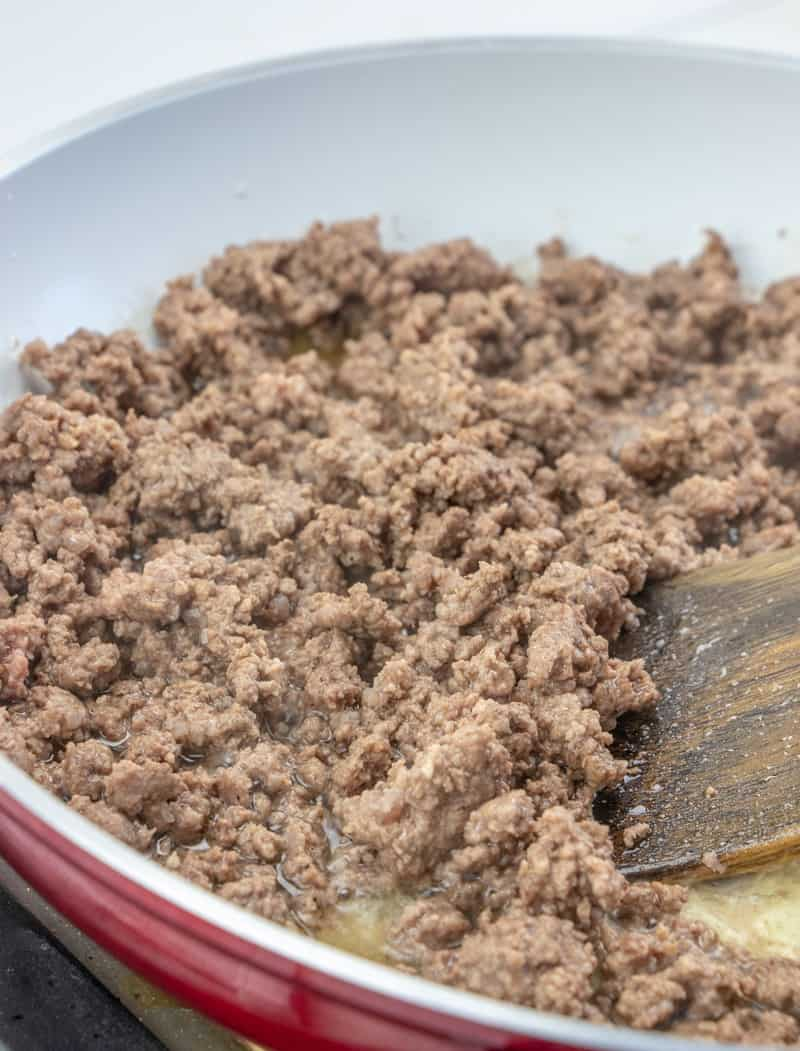 browning ground beef in a skillet.