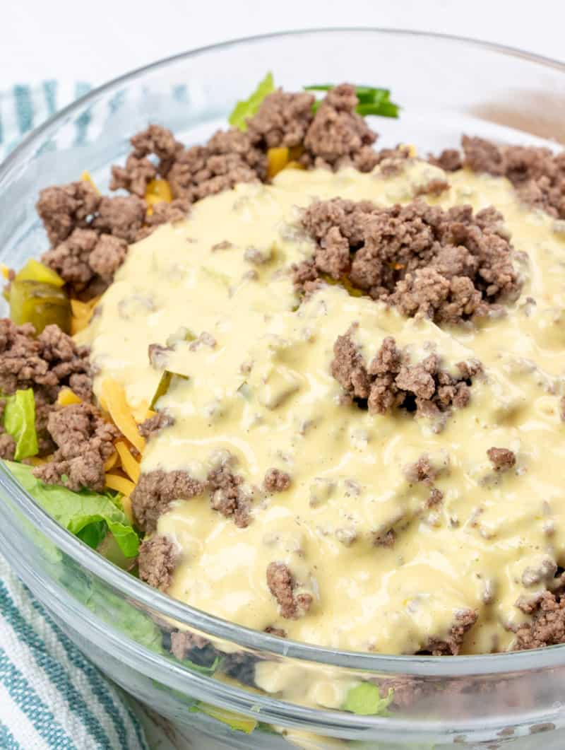 low carb cheeseburger salad ingredients mixed together in a large bowl.