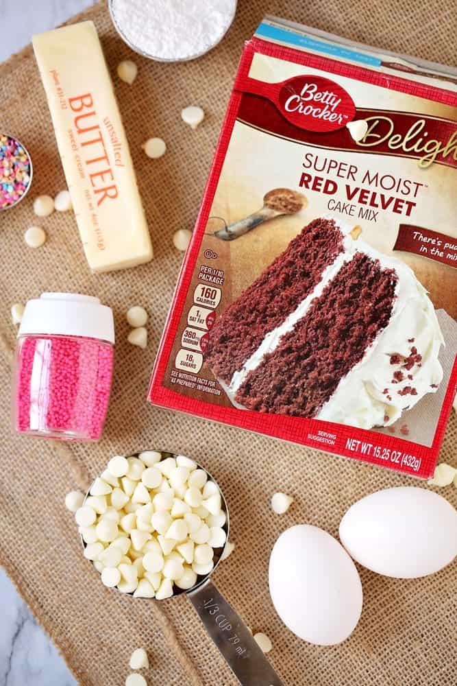 red velvet cake mix, butter, white chocolate chips, eggs, sprinkles