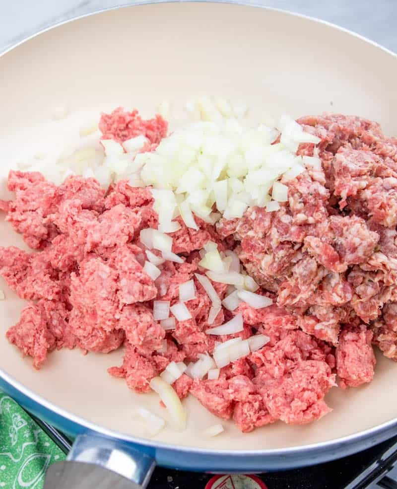 ground beef, sausage, onion, salt and pepper on a large skillet