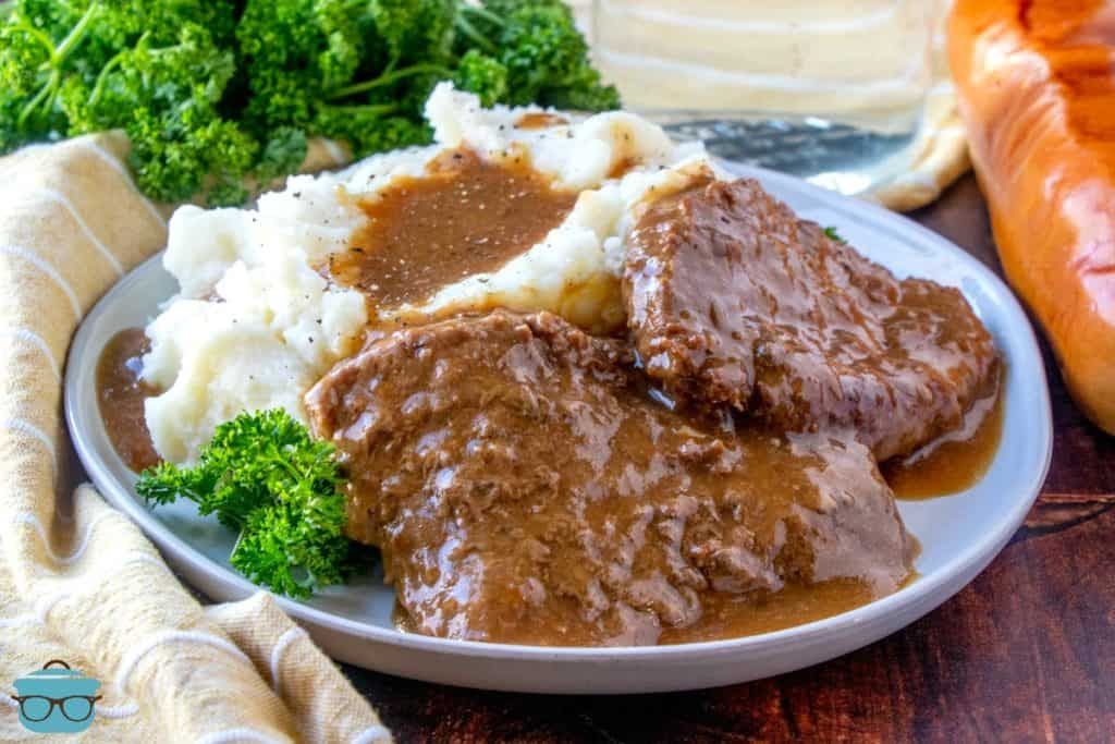 inished, Instant Pot Cubed Steak with Gravy on a plate served with mashed potatoes