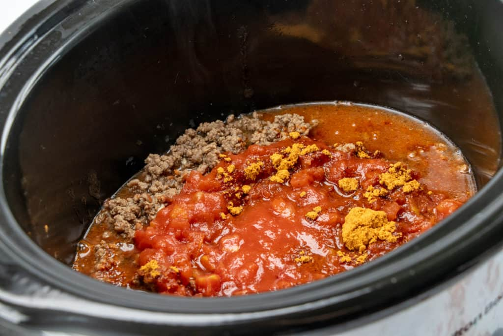 ground beef, diced tomatoes, water and taco seasoning in a slow cooker