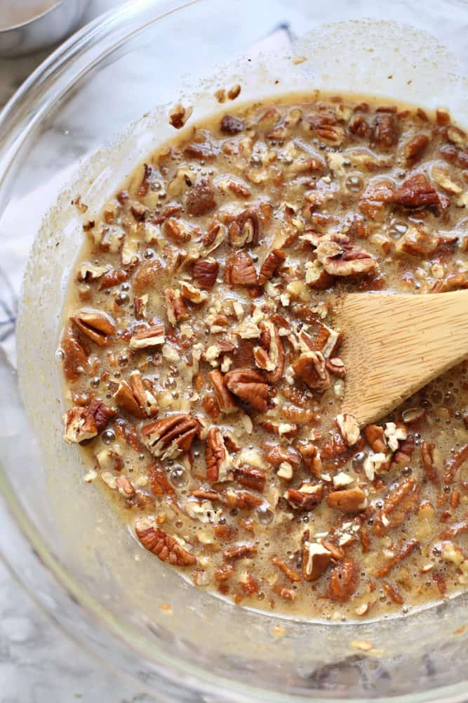 pecan pie filling mixture made with eggs, brown sugar, chopped pecans, corn syrup