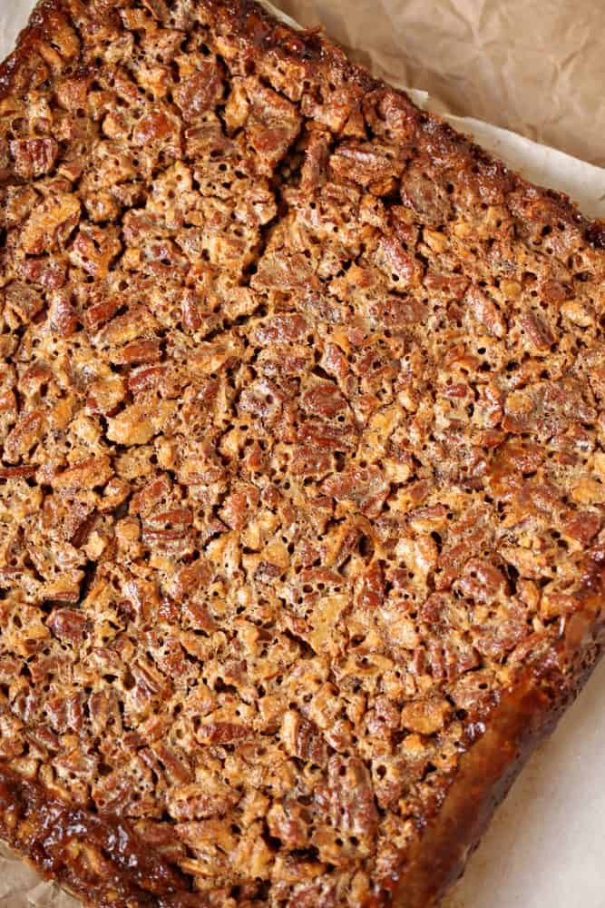 Pecan Pie Bars cooling on parchment paper