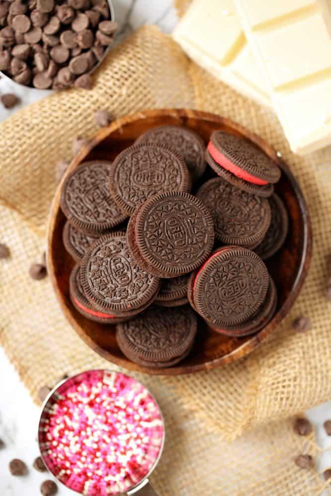 Oreo cookies, sprinkles, white chocolate, almond bark, chocolate chips