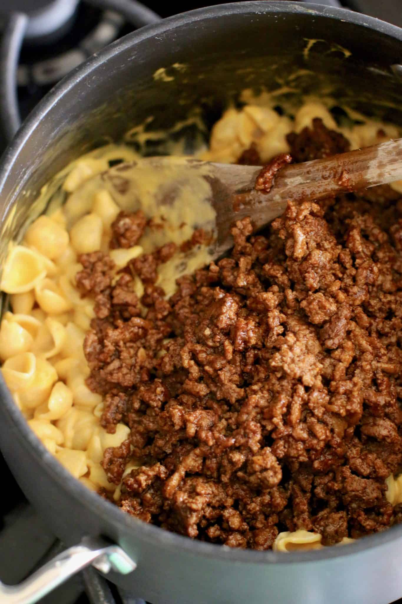 macaroni and cheese and taco ground beef in a large pot.