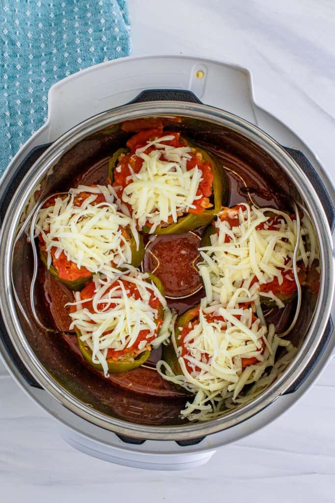 shredded mozzarella on stuffed peppers