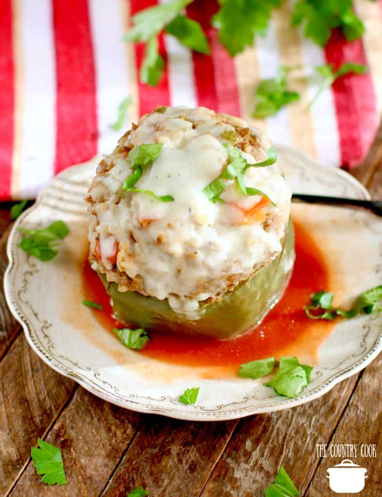 Instant Pot stuffed green peppers served with tomato sauce and topped with melted mozzarella cheese