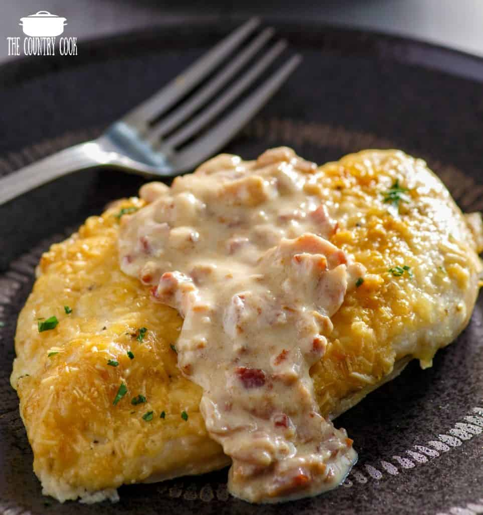 Parmesan and mayonnaise coated chicken breast with creamy bacon sauce