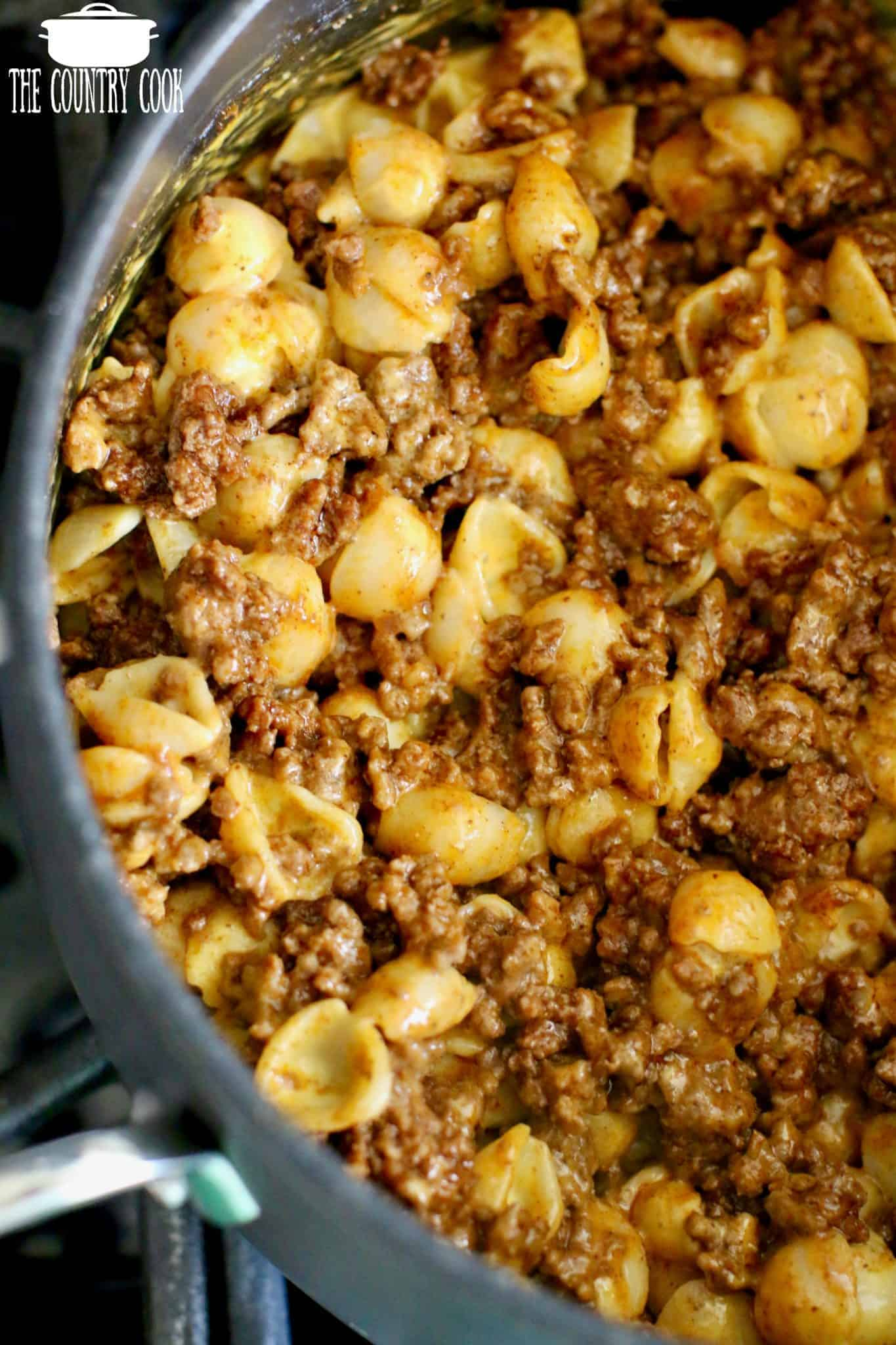 Taco Ground Beef mixed with Boxed Macaroni and Cheese in a large skillet.