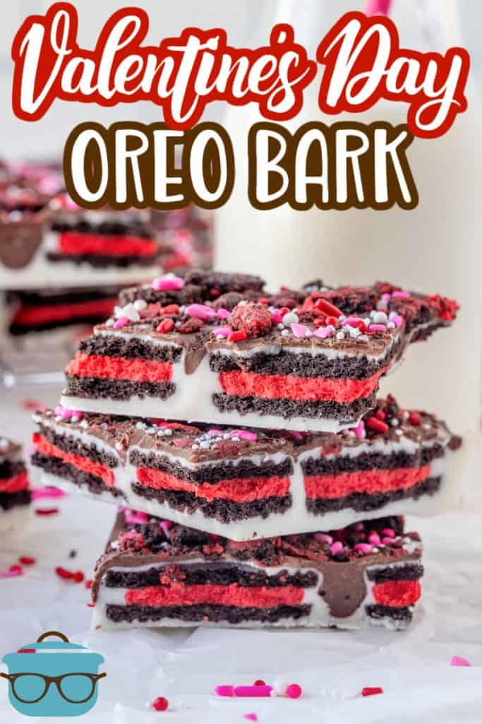 Valentine's Day Oreo Bark Recipe from The Country Cook, pictured are 3 pieces of Oreo cookie bark stacked on top of each other with a small glass bottle of milk in the background