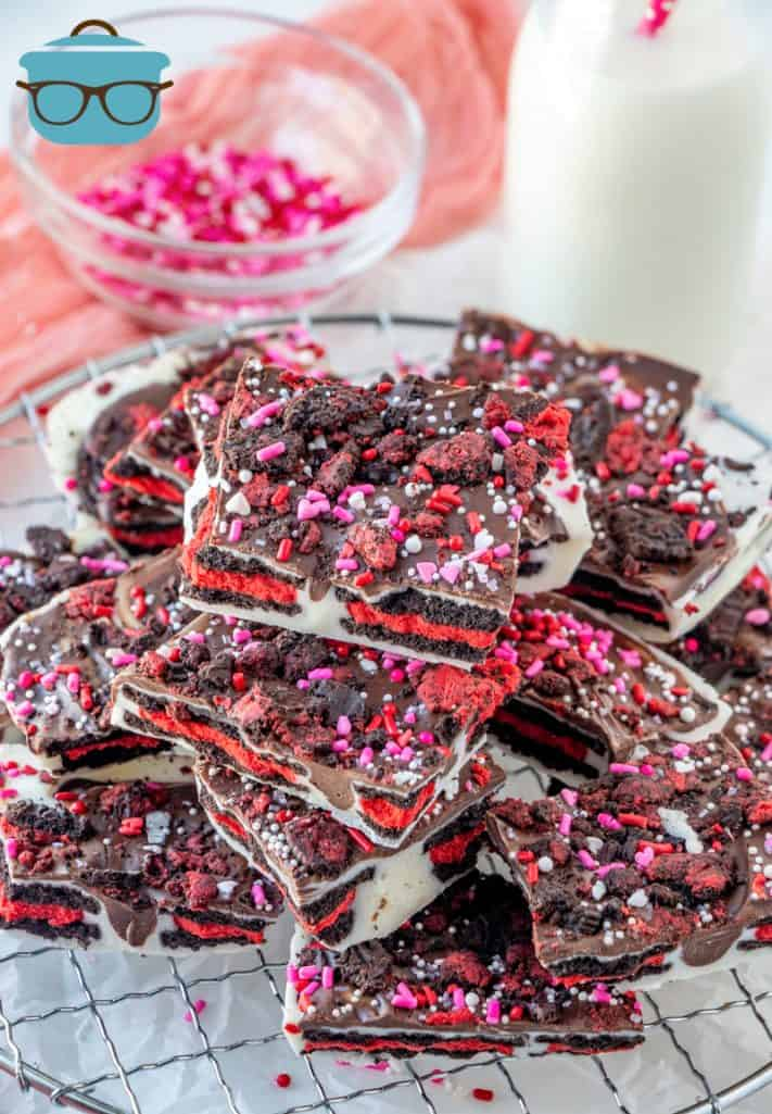 VALENTINE'S DAY OREO BARK, stacked in pieces on a round cooling rack