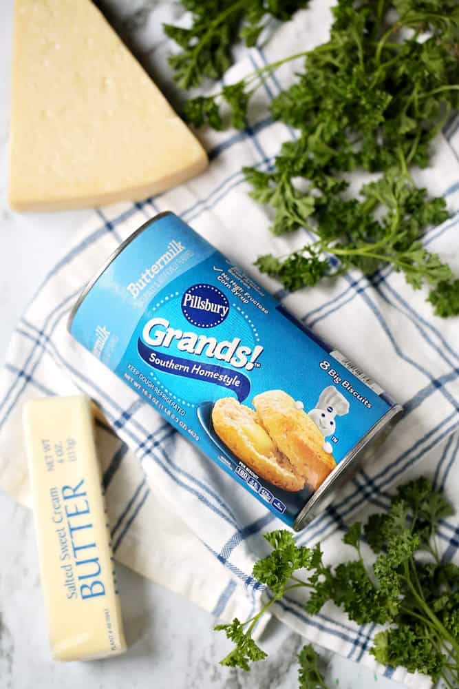 "Pillsbury Grands"" refrigerated biscuits, stick butter, parmesan cheese, garlic powder, parsley"