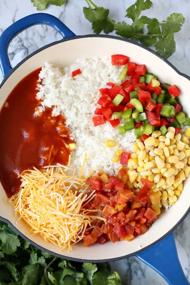 cooked rice, enchilada sauce, corn, Rotel, diced red and green peppers, shredded cheese