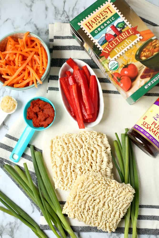 ramen noodles, green onions, sliced red pepper, julienned carrots, vegetable broth, red curry paste, minced garlic, sesame oil